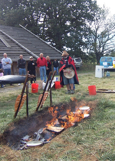 Men standing behind fire